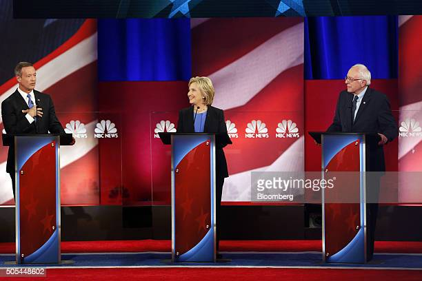 Martin O'Malley former governor of Maryland and 2016 Democratic presidential candidate left speaks as Hillary Clinton former Secretary of State and...