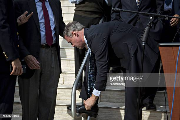 Martin O'Malley former governor of Maryland and 2016 Democratic presidential candidate ties his shoe after speaking to a congregation at the All...