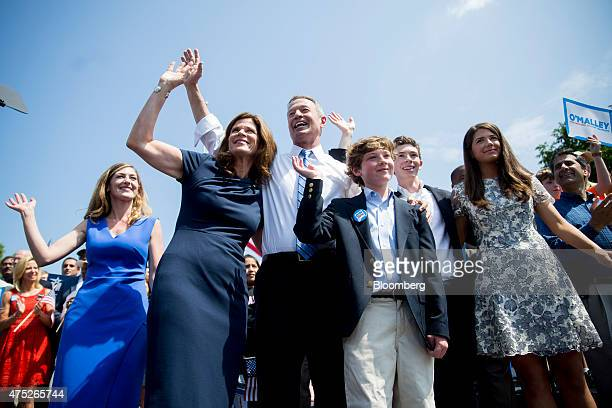 Martin O'Malley, former governor of Maryland, center, waves to the crowd with his wife Katie O'Malley, second from left, and his family after...