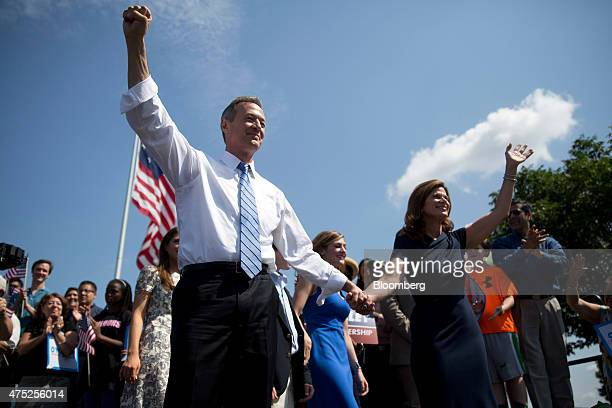 Martin O'Malley, former governor of Maryland, left, gestures as he arrives with his wife Katie O'Malley to announce he will seek the Democratic...