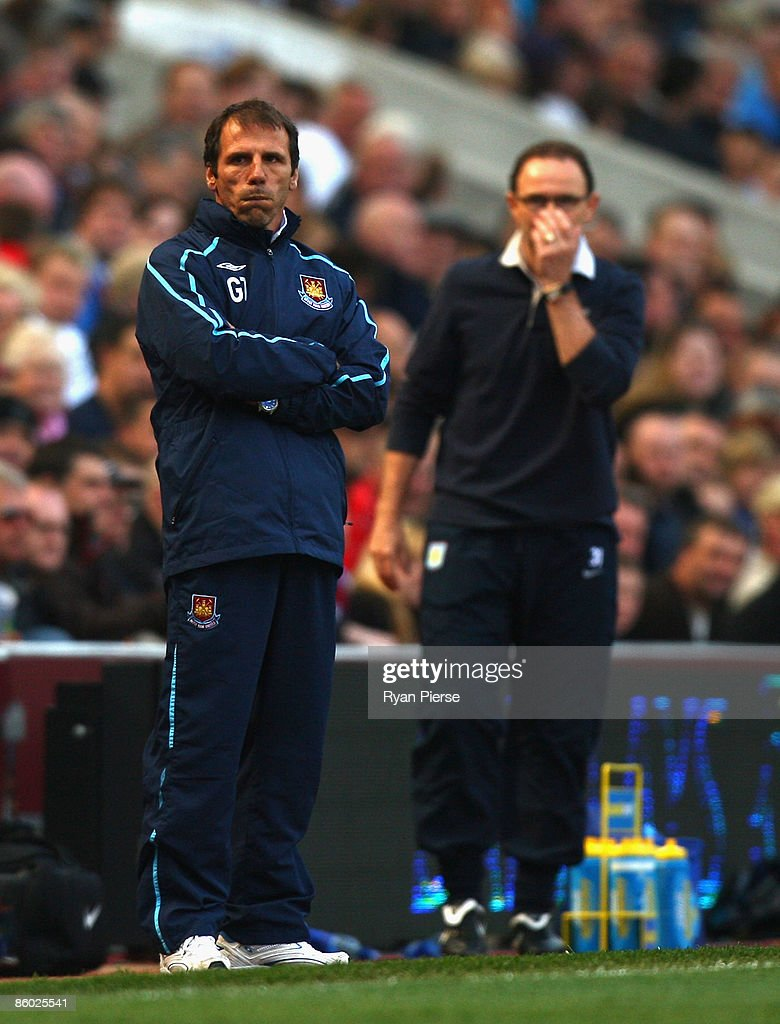 Martin O'Neill (R) , manager of Aston Villa and Gianfranco Zola (L), manager of West Ham, look on during the Barclays Premier League match between Aston Villa and West Ham United at Villa Park on April 18, 2009 in Birmingham, England.