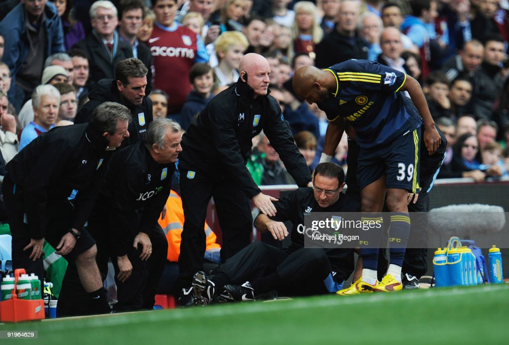 Martin O'Neill manager of Aston Villa (2R) is given assistance after colliding with Nicolas Anelka of Chelsea (R) during the Barclays Premier League match between Aston Villa and Chelsea at Villa Park on October 17, 2009 in Birmingham, England.
