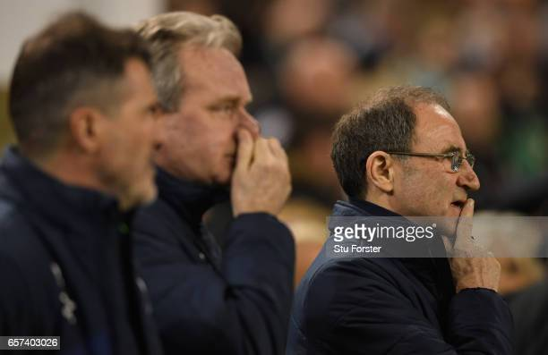 Martin O'Neill manager of the Republic of Ireland looks on alongisde Roy Keane assistant manager of the Republic of Ireland and Steve Walford coach...