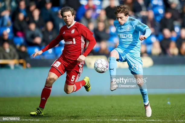 Martin Ornskov of Lyngby BK and Saba Lobzhanidze of Randers FC compete for the ball during the Danish Alka Superliga match between Randers FC and...