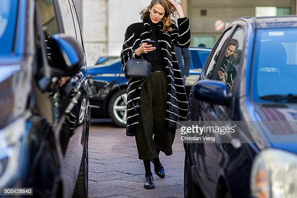 Martin outside Salvatore Ferragamo during Milan Men's Fashion Week Fall/Winter 2016/17 on January 17 in Milan Italy