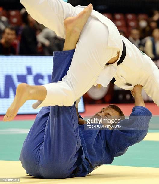 Martin Pacek of Sweden fights with Lukas Krpalek of the Czech Republic during their men's under 100kg semifinal match in the GrandSlam Tokyo 2013...