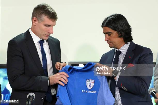 Martin Palermo new head coach of Pachuca and Marco Garces sports director of Pachuca pose with the jersey of the team during a press conference to...