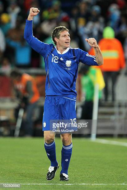 Martin Palermo of Argentina celebrates scoring the second goal with team mates during the 2010 FIFA World Cup South Africa Group B match between...