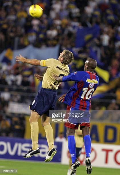 Martin Palermo of Argentina's Boca Juniors and Gergory Lancken of Venezuela's Union Atletico Maracaibo jump for the ball during a Libertadores Cup...