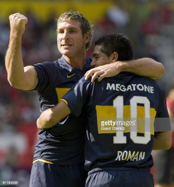 Martin Palermo of Argentinian Boca Juniors celebrates his goal against Mexican Atlas with Juan Roman Riquelme during their Libertadores Cup...