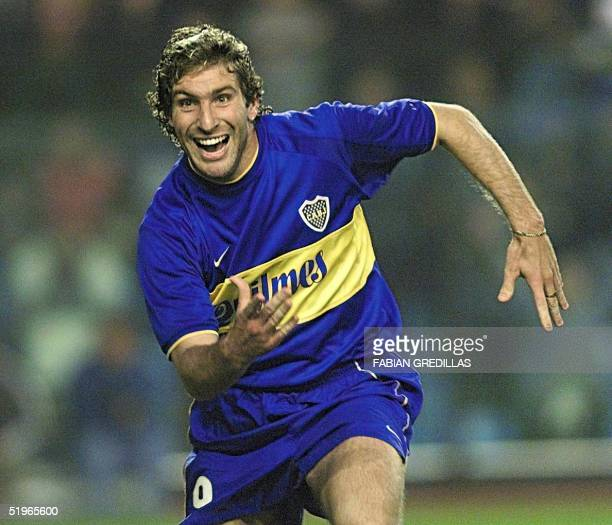 Martin Palermo of Boca Juniors celebrates after his team scored the third goal against River Plate 24 May 2000 at the La Bombonera stadium of Buenos...