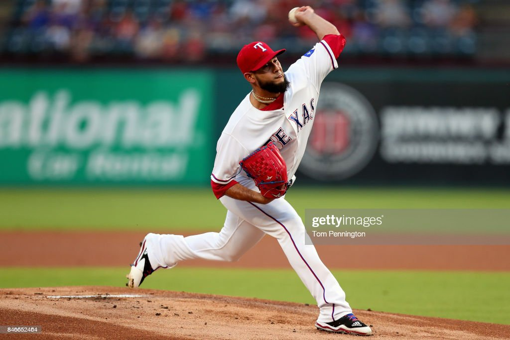 Martin Perez #33 of the Texas Rangers pitches against the Seattle Mariners in the top of the first inning at Globe Life Park in Arlington on September 13, 2017 in Arlington, Texas.