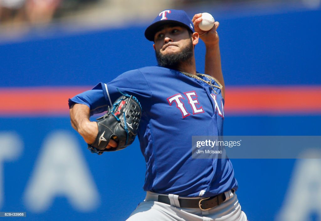 Martin Perez #33 of the Texas Rangers pitches in the first inning against the New York Mets at Citi Field on August 9, 2017 in the Flushing neighborhood of the Queens borough of New York City.