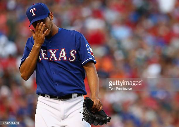 Martin Perez of the Texas Rangers reacts after being pulled from the game against the Baltimore Orioles in the top of the seventh inning at Rangers...