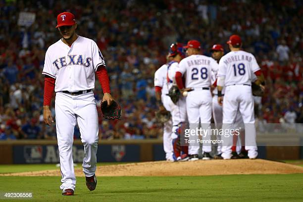 Martin Perez of the Texas Rangers walks back to the dugout after being pulled in the sixth inning against the Toronto Blue Jays during game three of...