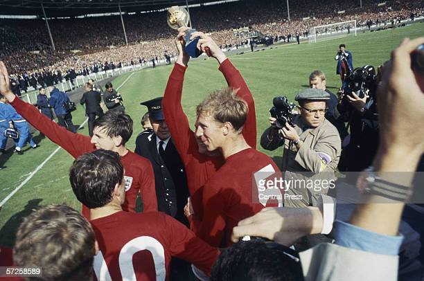 Martin Peters and Jack Charlton celebrate on the pitch after England's victory in the 1966 World Cup final at Wembley 30th July 1966 Captain Bobby...