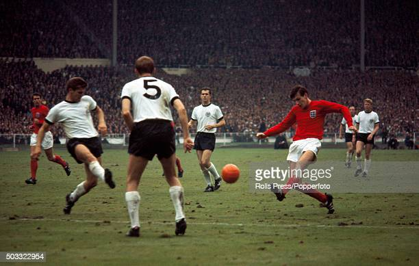 Martin Peters of England crosses the ball past West Germany's Wolfgang Weber watched by Willi Schulz and Franz Beckenbauer during the FIFA World Cup...