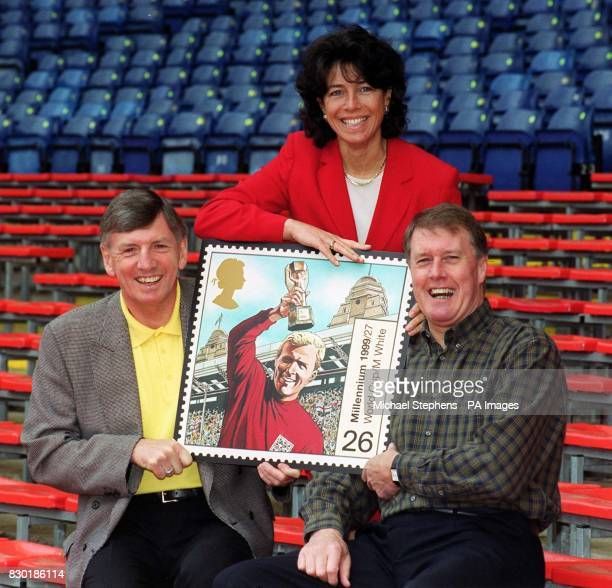 Martin Peters Stephanie Moore and Sir Geoff Hurst at Wembley Stadium London to unveil the latest Royal Mail Millennium Stamp The stamp pays tribute...
