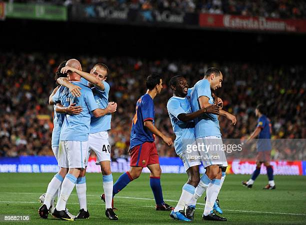 Martin Petrov of Manchester City celebrates his goal with Shaun WrightPhillips and other teammates during the Joan Gamper Trophy match between...