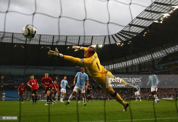 Martin Petrov of Manchester City scores the second goal past Mark Schwarzer of Fulham during the Barclays Premier League match between Manchester...