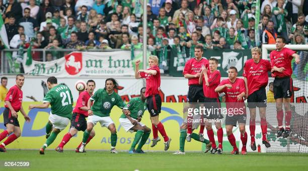 Martin Petrov of Wolfsburg takes a shot against a wall of players of Nurnberg during The Bundesliga Match between Vfl Wolfsburg and 1 FC Nurnberg at...