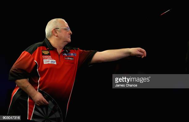 Martin Phillips of Wales in action against Daniel Day during the First Round of the BDO World Darts Championship at Lakeside Country Club on January...