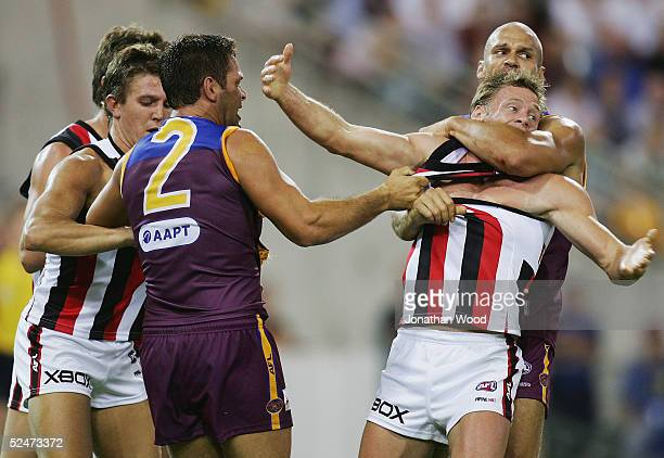 Martin Pike of the Lions wrestles with Andrew Thompson of the Saints during the round one AFL match between the Brisbane Lions and Saint Kilda Saints...