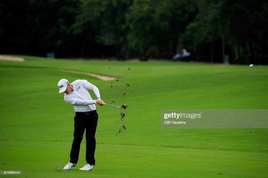 Martin Piller of the United States plays a shot on the ninth hole during the continuation of the second round of the OHL Classic at Mayakoba on November 11, 2017 in Playa del Carmen, Mexico.