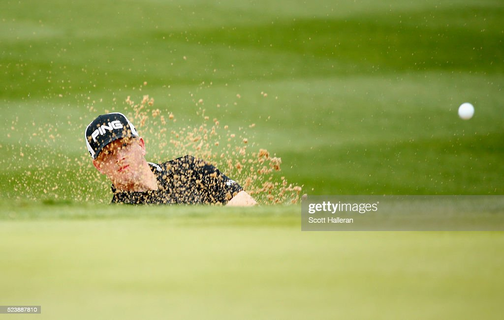 Martin Piller takes his shot out of the bunker on the 13th hole during the final round of the Valero Texas Open at TPC San Antonio AT&T Oaks Course on April 24, 2016 in San Antonio, Texas.