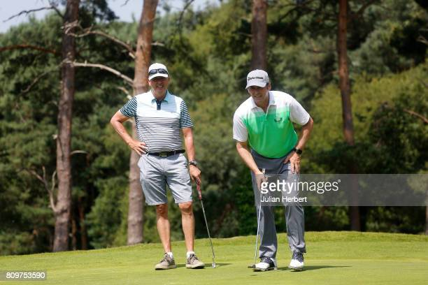 Martin Porter and Nick St John of Enfield Golf Club line up a putt during The Lombard Trophy South west Qualifier at Parkstone Golf Club on July 6...