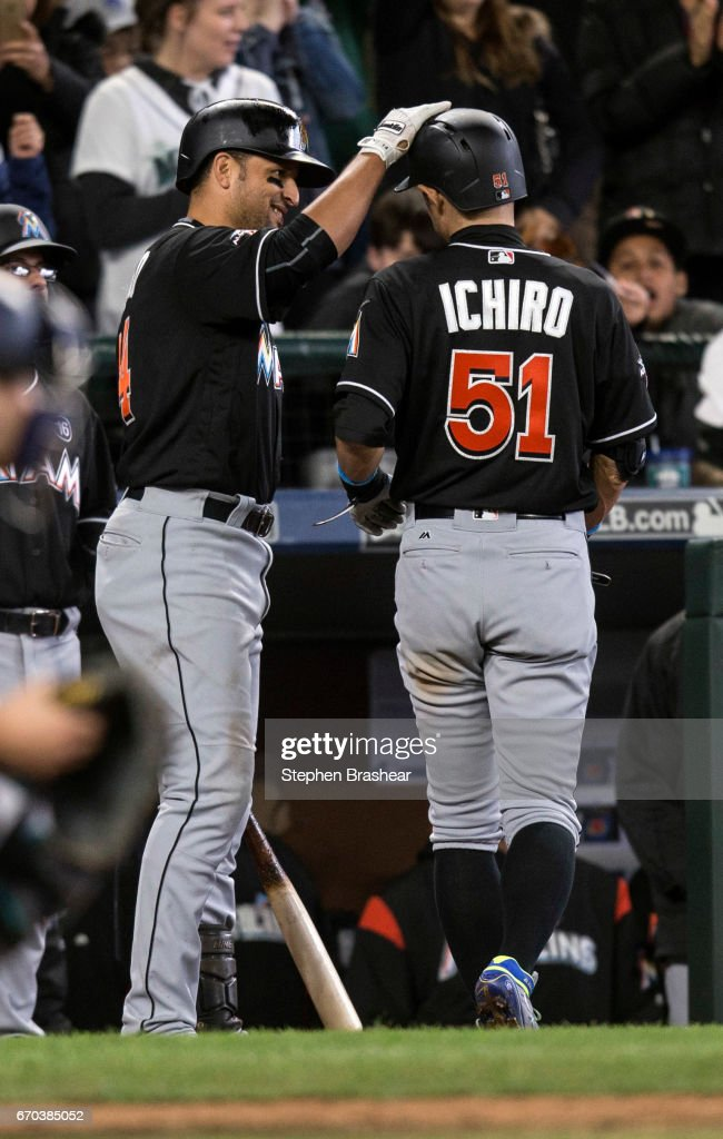 Martin Prado #14, left, of the Miami Marlins congratulates Ichiro Suzuki #51 of the Miami Marlins after Ichiro hit a solo home run off of relief pitcher Justin Bour #41 of the Miami Marlins during the ninth inning of a game at Safeco Field on April 19, 2017 in Seattle, Washington. The Marins 10-5.