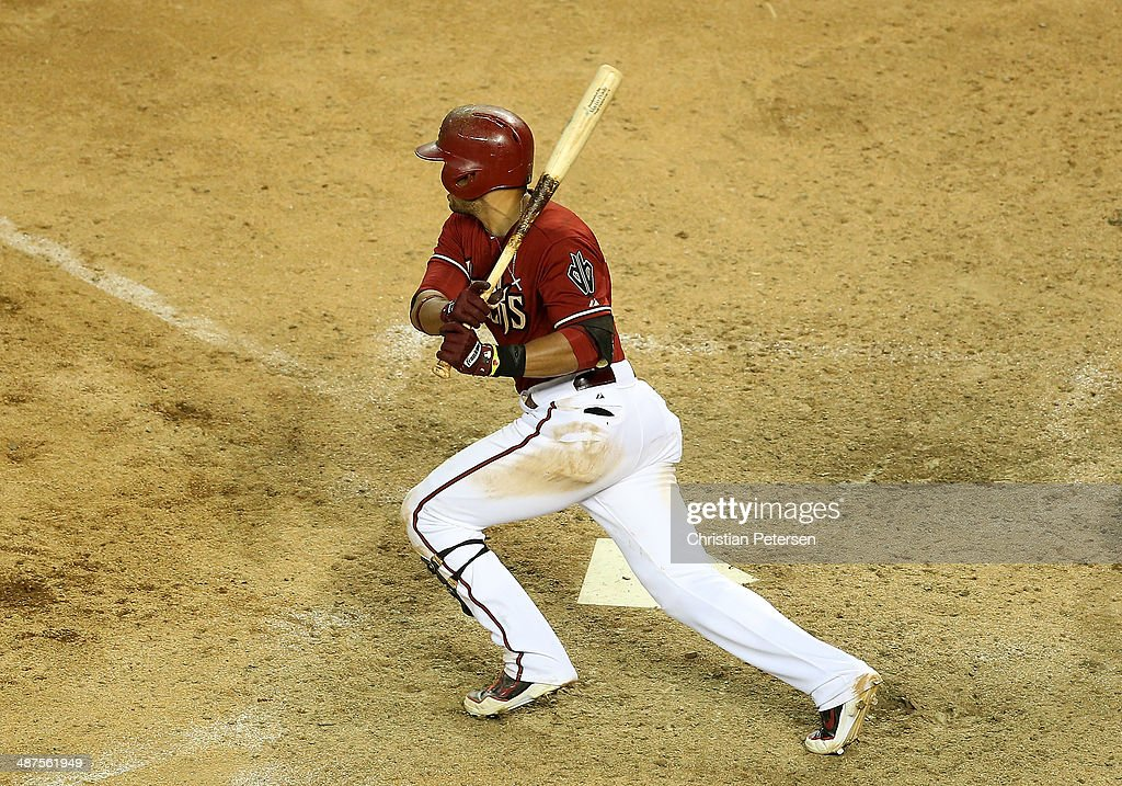 Martin Prado #14 of the Arizona Diamondbacks hits a two RBI single against the Colorado Rockies during the ninth inning of the MLB game at Chase Field on April 30, 2014 in Phoenix, Arizona. The Diamodbacks defeated the Rockies 5-4 in 10 innings.