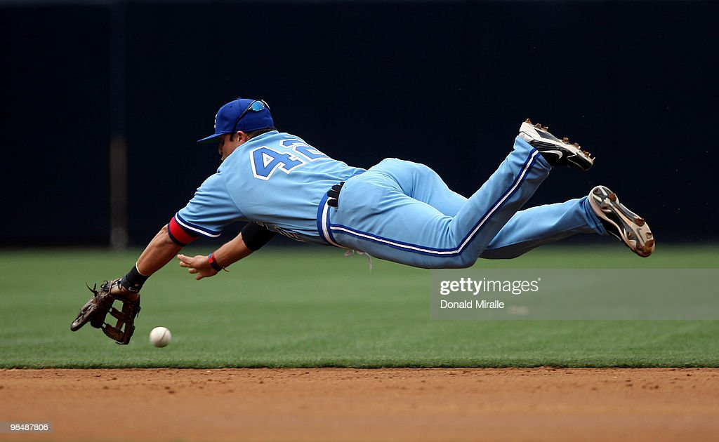 Martin Prado of the Atlanta Braves dives and misses a catch during action against the San Diego Padres MLB Game at Petco Park on April 15, 2010 in San Diego, California. All Major League players joined in wearing #42 today in honor of Jackie Robinson, who broke baseball's color barrier in 1947 when he debuted with Brooklyn Dodgers.