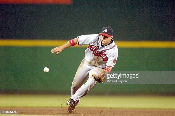 Martin Prado of the Atlanta Braves fields a ground ball during a game against the Washington Nationals on April 23 2006 at RFK Stadium in Washington...