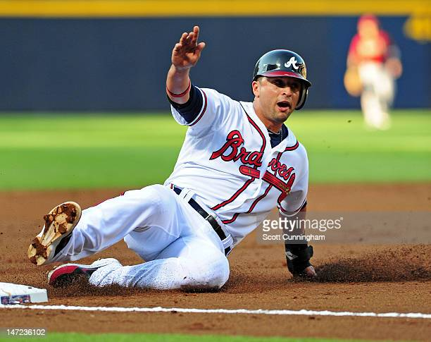 Martin Prado of the Atlanta Braves steals third base against the Arizona Diamondbacks at Turner Field on June 27 2012 in Atlanta Georgia