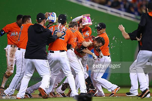 Martin Prado of the Miami Marlins celebrates with teammates after hitting a walkoff sacrifice fly ball to end the game against the New York Mets at...