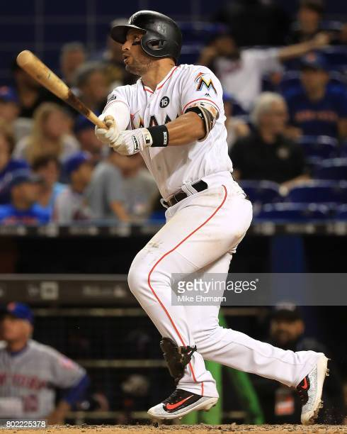 Martin Prado of the Miami Marlins hits during a game against the New York Mets at Marlins Park on June 27 2017 in Miami Florida
