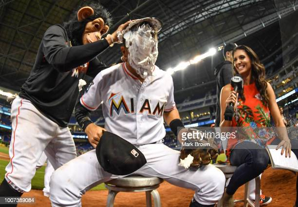 Martin Prado of the Miami Marlins is creamed by The Monkey during an interview after beating the Washington Nationals at Marlins Park on July 29 2018...