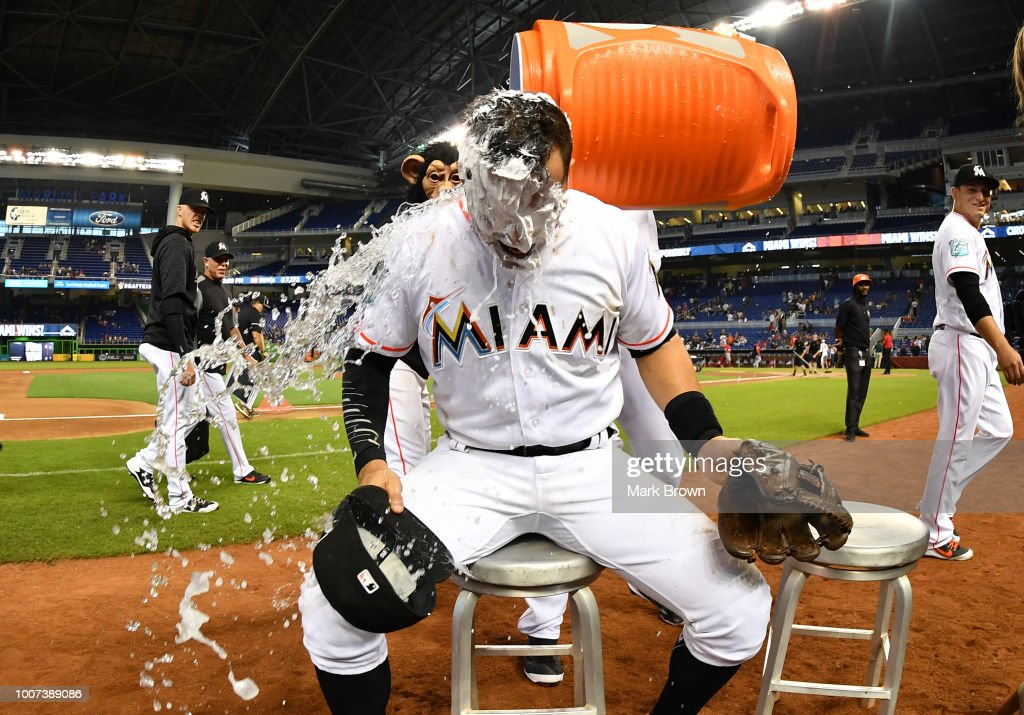 Martin Prado #14 of the Miami Marlins is doused with water after being creamed by The Monkey during an interview after beating the Washington Nationals at Marlins Park on July 29, 2018 in Miami, Florida.