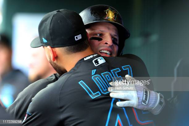 Martin Prado of the Miami Marlins is hugged by Pablo Lopez after hitting a home run against the Philadelphia Phillies during the third inning of a...
