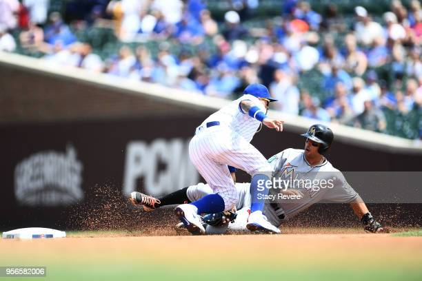 Martin Prado of the Miami Marlins is tagged out at second base by Javier Baez of the Chicago Cubs during the first inning of a game at Wrigley Field...