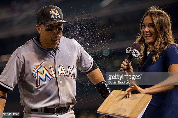 Martin Prado of the Miami Marlins reacts after being doused with Powerade and ice by Miguel Rojas while giving a post game interview to Fox reporter...
