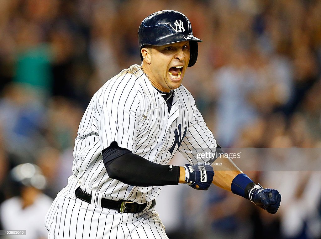 Martin Prado #14 of the New York Yankees reacts after his game-winning ninth inning base hit against the Chicago White Sox at Yankee Stadium on August 22, 2014 in the Bronx borough of New York City.