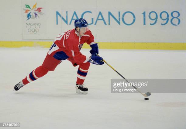 Martin Prochazka of the Czech Republic controls the puck during the Group C game against Russia in the Men's Ice Hockey tournament on 16 February...