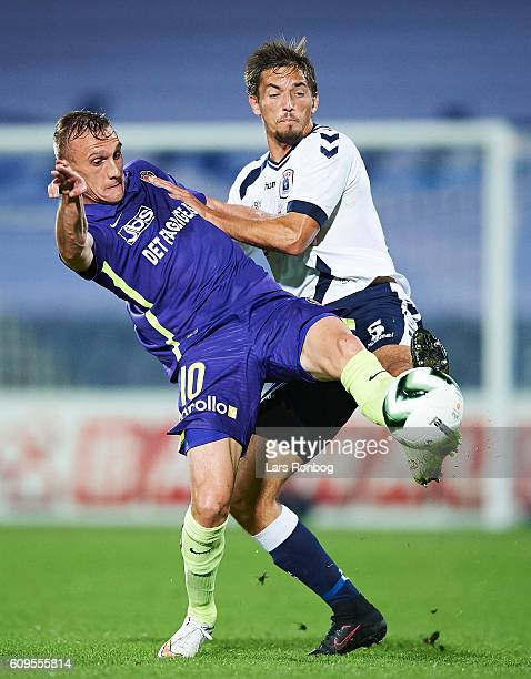 Martin Pusic and Alexander Juel Andersen of AGF Aarhus compete for the ball during the Danish Alka Superliga match between AGF Aarhus and FC...