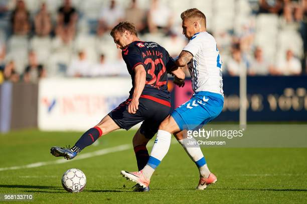 Martin Pusic of AGF Arhus and Marco Lund of OB Odense compete for the ball during the Danish Alka Superliga match between OB Odense and AGF Arhus at...