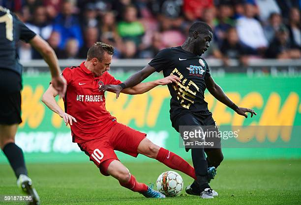 Martin Pusic of FC Midtjylland and Badou Papa Alioune Ndiaye of Osmanlispor FK compete for the ball during the UEFA Europa League playoff 1st leg...
