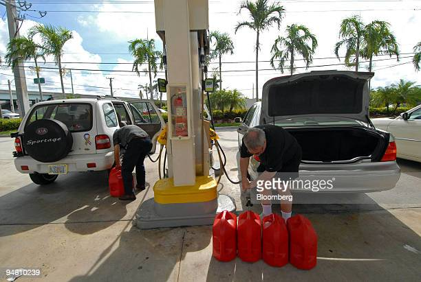 Martin R Press of Plantation Florida fills up five gallon containers with gasoline at a Davie Florida gas station as he prepared for Tropical Storm...