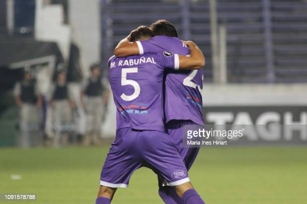 Martin Rabuñan of Defensor Sporting celebrates with teammate Alvaro Navarro after scoring the first goal of his team during a match between Defensor...