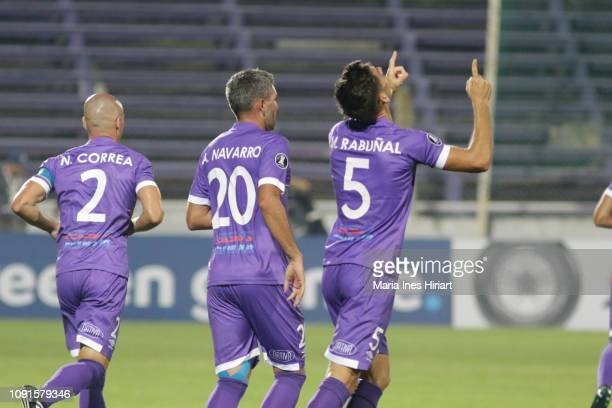 Martin Rabuñan of Defensor Sporting celebrates with teammate Alvaro Navarro after scoring the first goal of his team a match between Defensor...